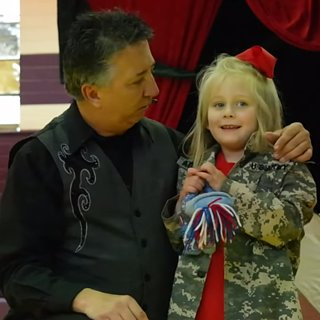 Military Mom and Dad Surprise Daughter at School Magic Show