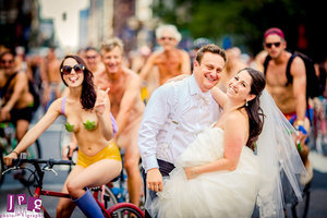 Wedding Couple Photobombed by Thousands of Nude Cyclists For the Most Memorable Pics Ever