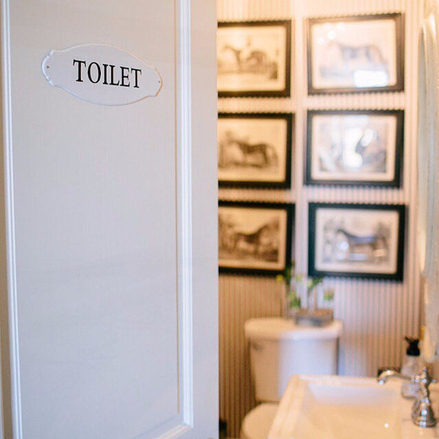Vintage Signs Help Guests Looking for the Powder Room