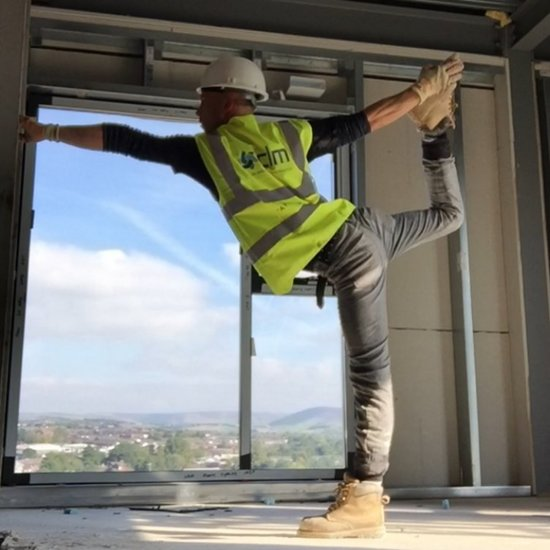 This Hot Builder Is Taking Workplace Yoga to the Next Level