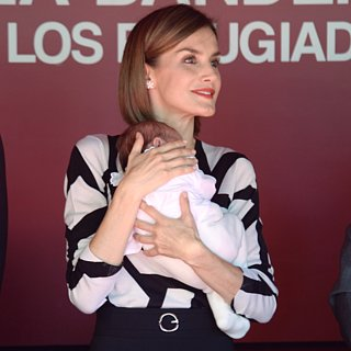 Queen Letizia Holds a Baby in Madrid Pictures