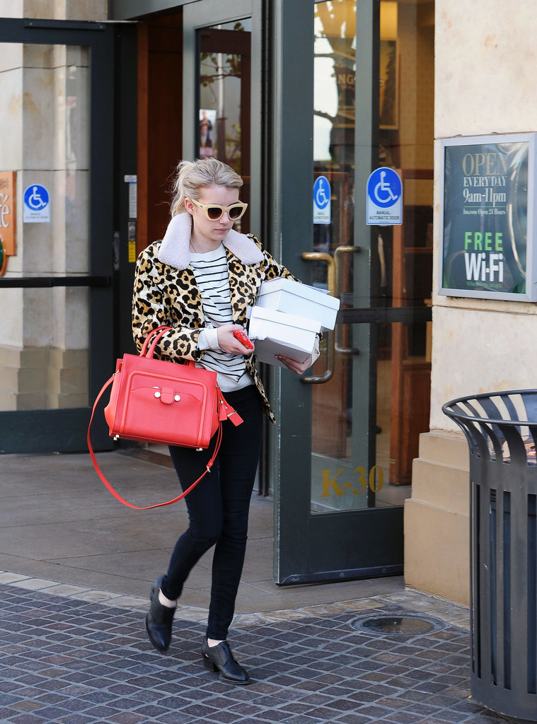 A leopard coat even works with casual outfits. Emma elaved her striped sweater and black jeans by mixing prints and adding the spotted style.