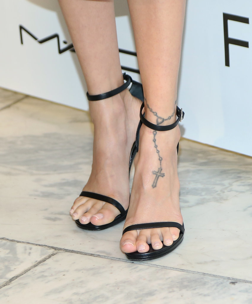 Another memorable tattoo on the Candidly Nicole star is her rosary anklet.