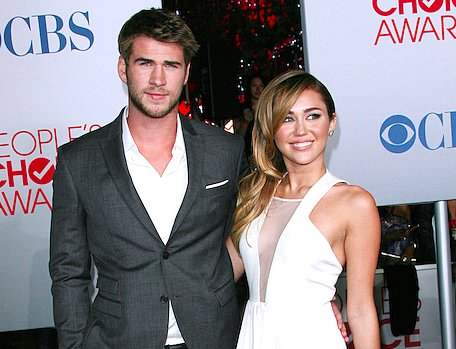 Looks Like Liam Hemsworth Put a Ring on Miley Cyrus -- Again! (PHOTOS)