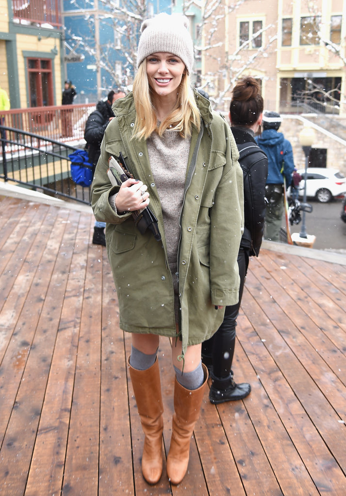 We'd happily take a page from Brooklyn Decker's easy, cool-girl Winter look — just toss an anorak over your sweater dress.