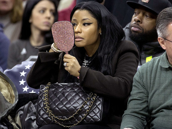 Nicki Minaj Doesn't Let Sitting Courtside Stop Her from Doing a Little Makeup Touch-up