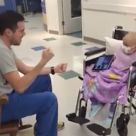 Male Nurse Singing to Little Girl With Cancer