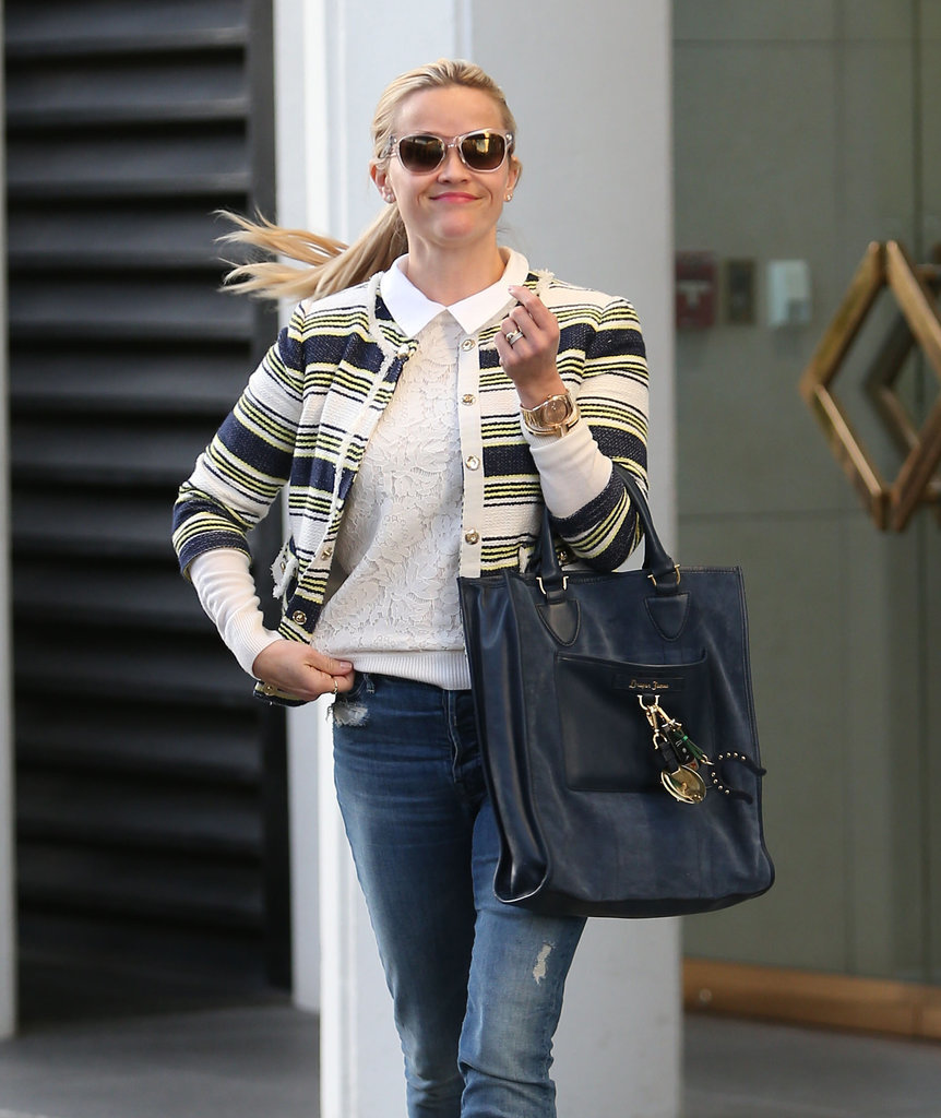 Her navy bag got a unique touch from a chunky keychain.