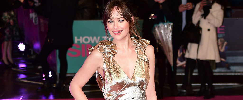 Dakota Johnson Wears a Golden Gown Worth Saving From the Rain
