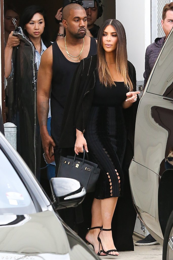 Kim toted her black Hermès bag and finished her outfit with a statement ring and tall sandals.