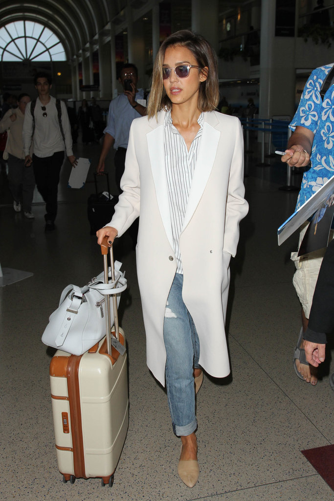 Jessica knows how to travel in style! She amped up a baggy pair of boyfriends with the help of a button-front shirt, a blazer, and pointy flats.