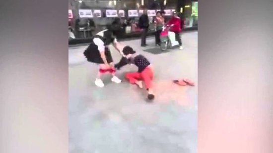 WATCH: People Stand By While A Guy Pulls Down His Girlfriend's Underwear Down In Public For Cheating