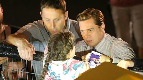Brad Pitt Saves Young Fan Being Crushed by Crowd -- See the Video