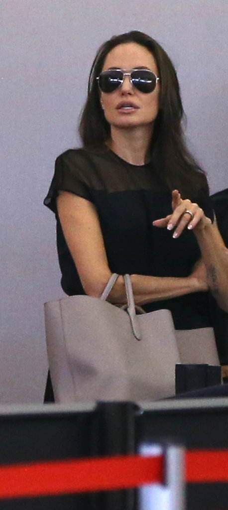 She Paired the Look With Aviator Shades and a Beige Tote