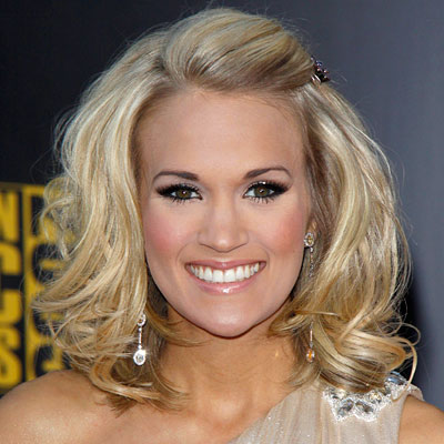THE STYLE A new (!) below-the-chin bob with piecey, bouncy waves  Carrie Underwood's fresh, short cut is unbearably cute, plus the side-swept, pinned back bangs add a prim—but still playful—touch.