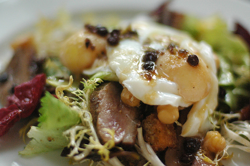Poached Eggs with Duck Breast on Greens