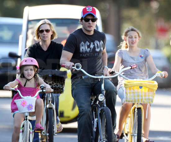 Slide Photo of Peter Faccinelli and Jennie Garth With Their Daughters Bike Riding