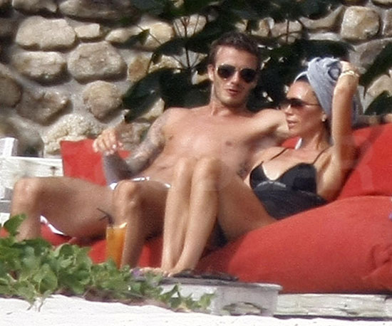 Slide Photo of David in His Speedos and Victoria Beckham in Swimsuit