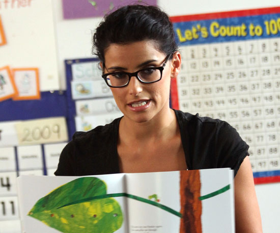 Slide Photo of Nelly Furtado Reading to Kids