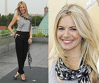 Actress Sienna Miller at G.I. Joe: The Rise Of Cobra Berlin Photocall in Black Pants and Gray Tank Top