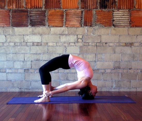 Strike a Yoga Pose: Headstand Bow