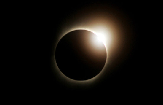 Front Page: Solar Eclipse Brings Darkness at Dawn