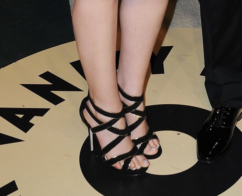 To go along with her sparkly blue Monique Lhuillier dress, Ginnifer Goodwin sported strappy black-and-gold Jimmy Choo sandals at the Vanity Fair bash.