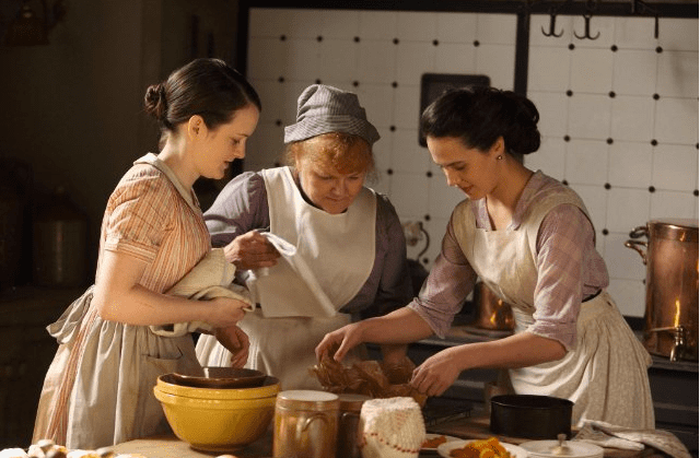 "Working women didn't catch a break from corsetry, either. Daisy, Mrs. Patmore, and the rest of the ""downstairs"" group would have worn corsets as they cooked, cleaned, and served in the home. Source: ITV"