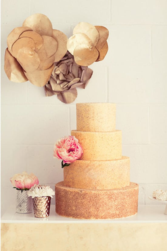 The shape of this cake is as unpretentious as it gets, but the gold color adds a striking touch.  Photo by Natalie Barrett Photography via Green Wedding Shoes