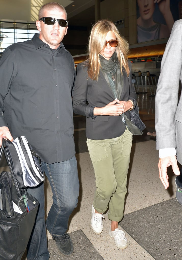 Jennifer Aniston looked cool in cargos and white sneakers as she departed LAX.