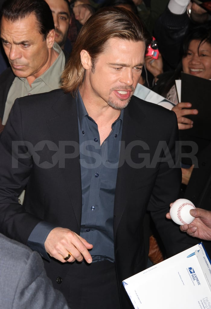 Brad Pitt greeted fans in NYC.