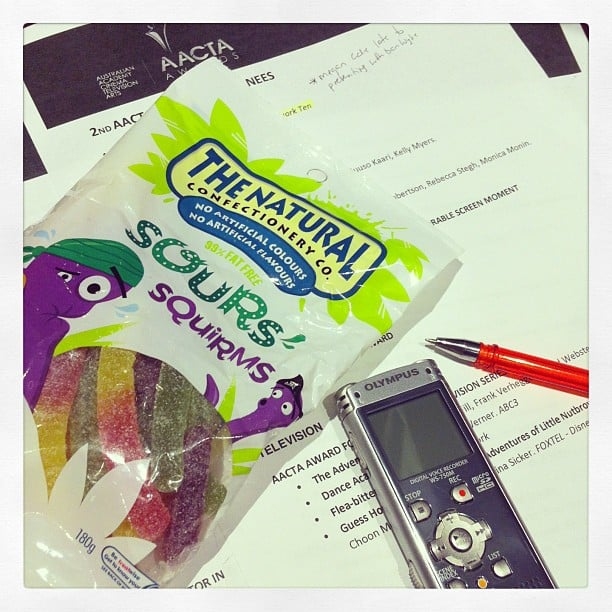 Essentials for a media room at an awards show? A dictaphone, a pen, and a truckload of lollies.