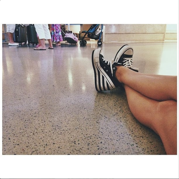 Betty Who rocked custom wedge sneakers en route from LAX to Chicago. Source: Instagram user iambettywho