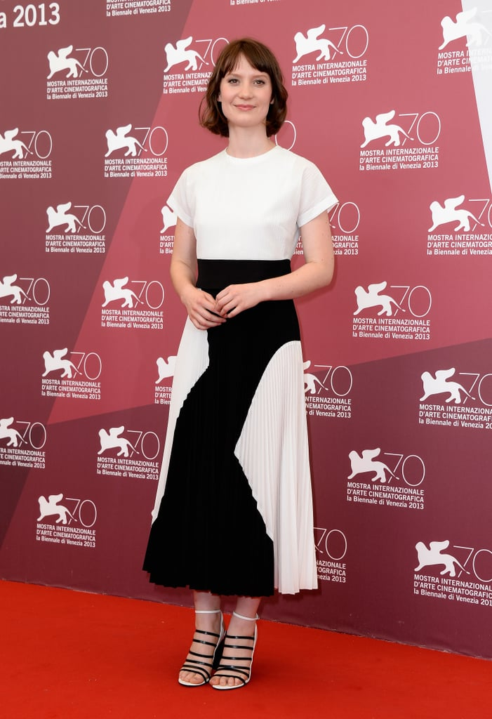 Mia Wasikowska got in on the black and white trend in a midi-length pleated Proenza Schouler dress and matching strappy sandals at the Tracks photo call at the Venice Film Festival.