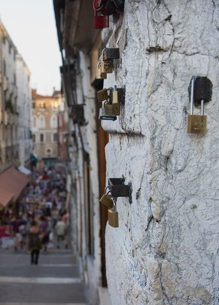 Love padlocks adorned a wall on Rialto Bridge in Venice, Italy.
