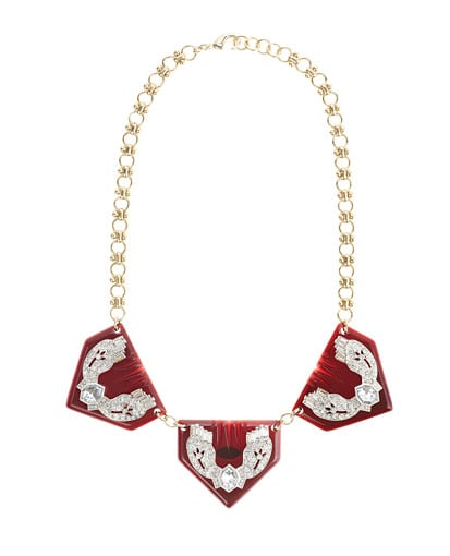 I was so excited to hear that J.Crew and Lulu Frost were collaborating again, and with big statement necklaces continuing to make a big statement for Fall, this Lulu Frost for J.Crew Triple Resin Triangle Necklace ($150) on my list because it's gorgeous, but not over-the-top. — Noria Morales, style director