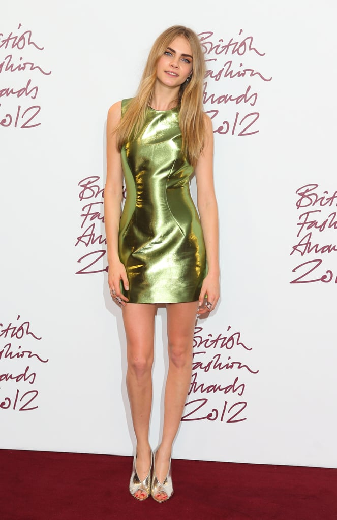 Cara Delevingne walked the red carpet at November's British Fashion Awards, showing off her mile-long legs in an iridescent green Burberry mini.