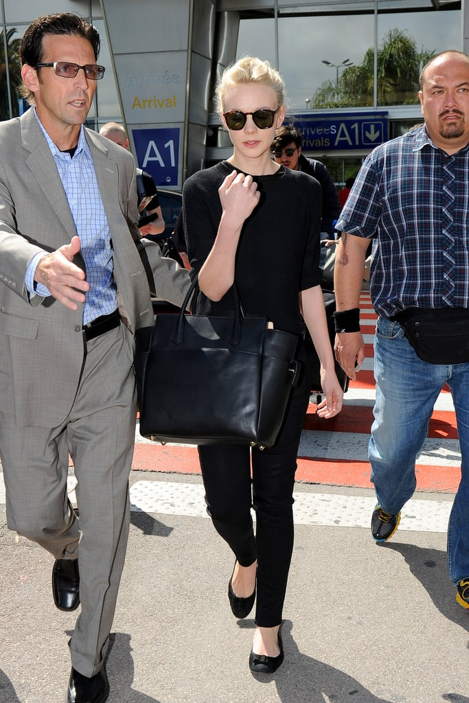 Carey Mulligan is the proof: all-black looks just as chic on the tarmac as it does at a cocktail party. A basic black tee, black skinnies, coordinating flats, dark shades, and a luxe black tote create a no-fail solution to looking sophisticated and cool, even if you're boarding time is 6 a.m.