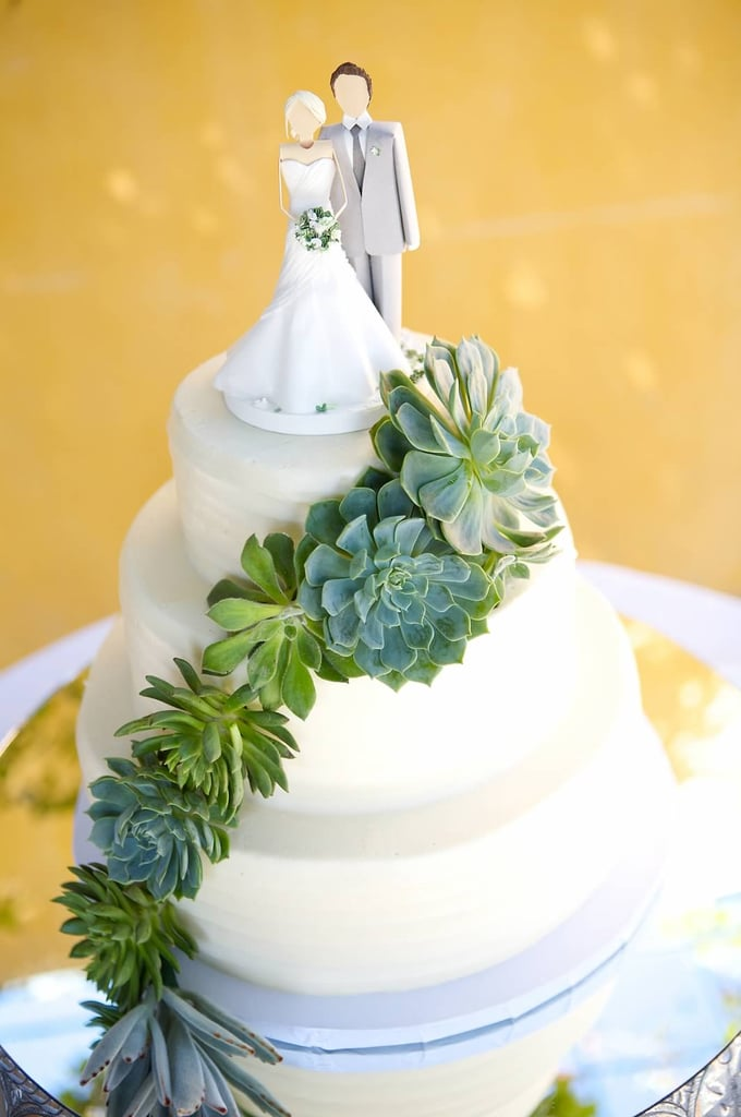 This whimsical cake topper is a masterpiece unlike any we've seen.
