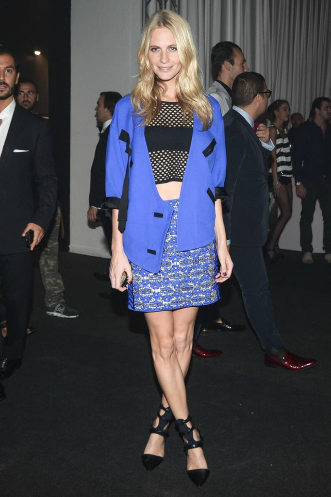 Poppy Delevingne arrived to La Permanente for amfAR's event in bright blue designs.