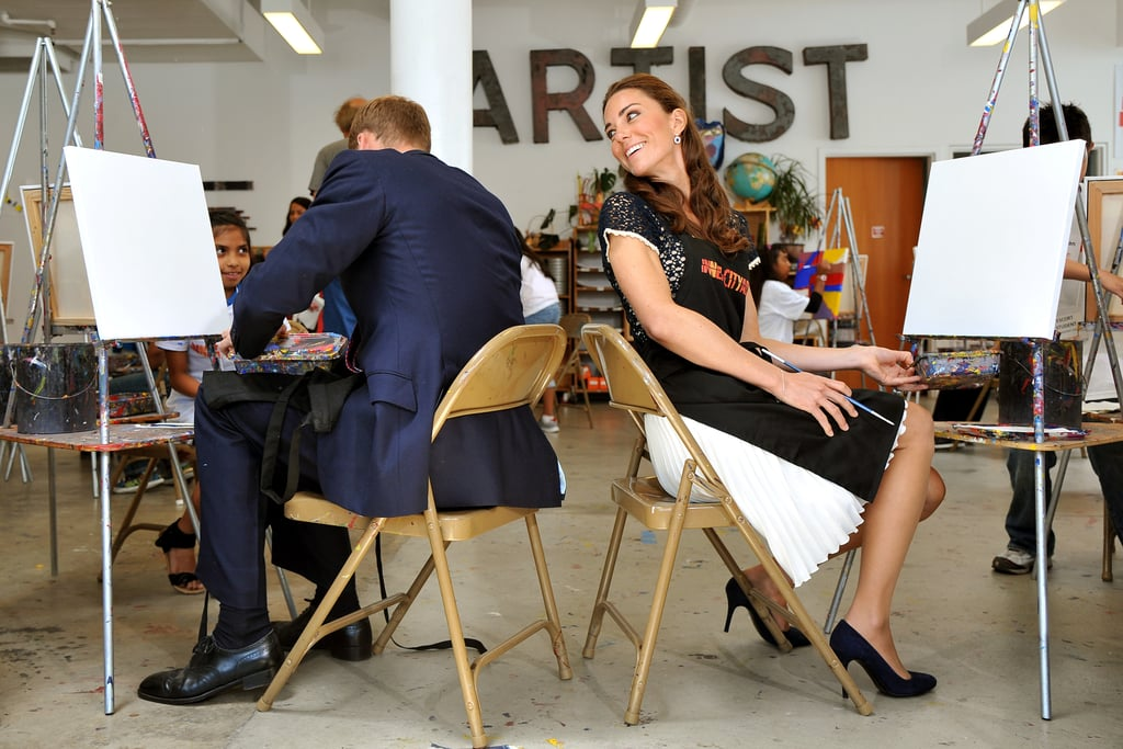 Kate Middleton checked on Prince William's status as they painted pictures at LA's Inner City Arts in July 2011.