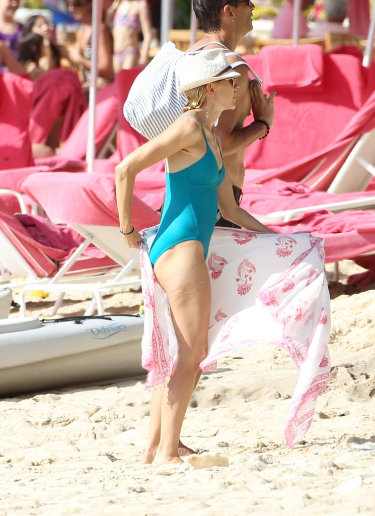 Naomi Watts wrapped up in a sarong on the beach in Barbados.