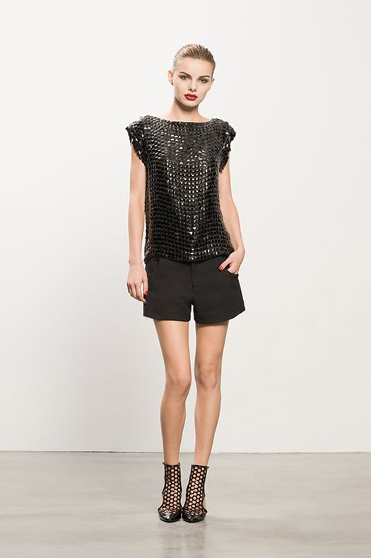 Boatneck Black Beaded Top ($495), Pique Black Shorts ($375), Secret Place Black Open Back Booties ($895) Photo courtesy of Tamara Mellon