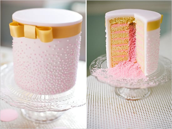 It's not just the outside of this cake that stands out for being dainty with its gold bow and pink dots— just look at the layers of yumminess inside.  Photo by Segerius Bruce Photography via Wedding Chicks