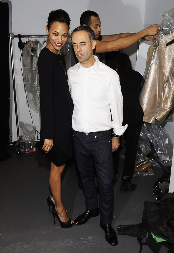 Zoe hung out backstage with Francisco Costa during the Fall 2011 Calvin Klein show, wearing a black sheath dress from the collection.