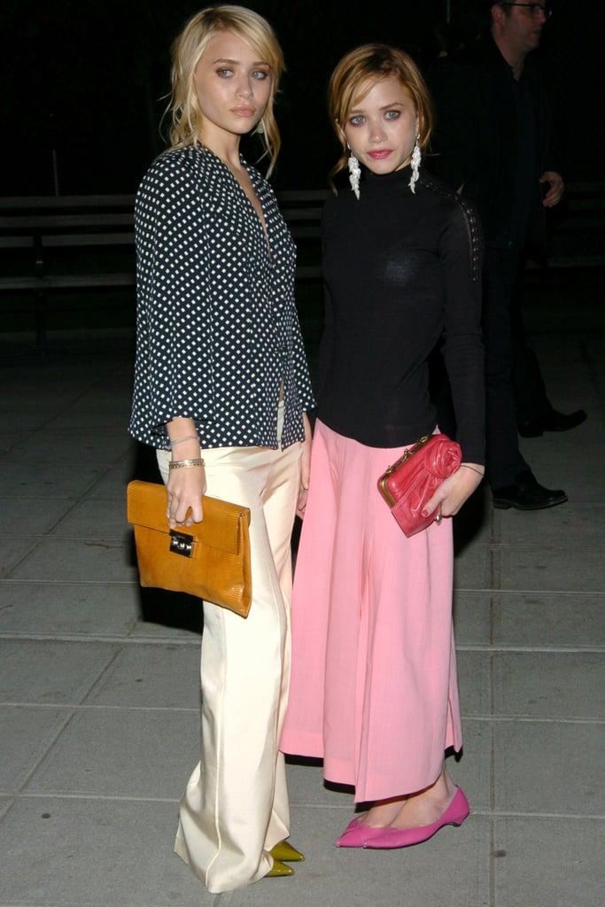 Twinning combo: For Vanity Fair's Tribeca Film Festival party, the twins chose girlie prints and hues.  Ashley styled a business-chic ensemble — polka-dot blouse and silky wide-leg trousers — with olive-green pumps and an orange leather clutch. Mary-Kate posed in a studded turtleneck, flowy pink skirt, matching kitten heels, and a hot-pink rose clutch.