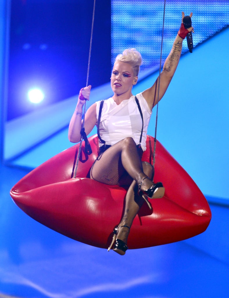 P!nk performed on a lip-shaped swing in 2012.