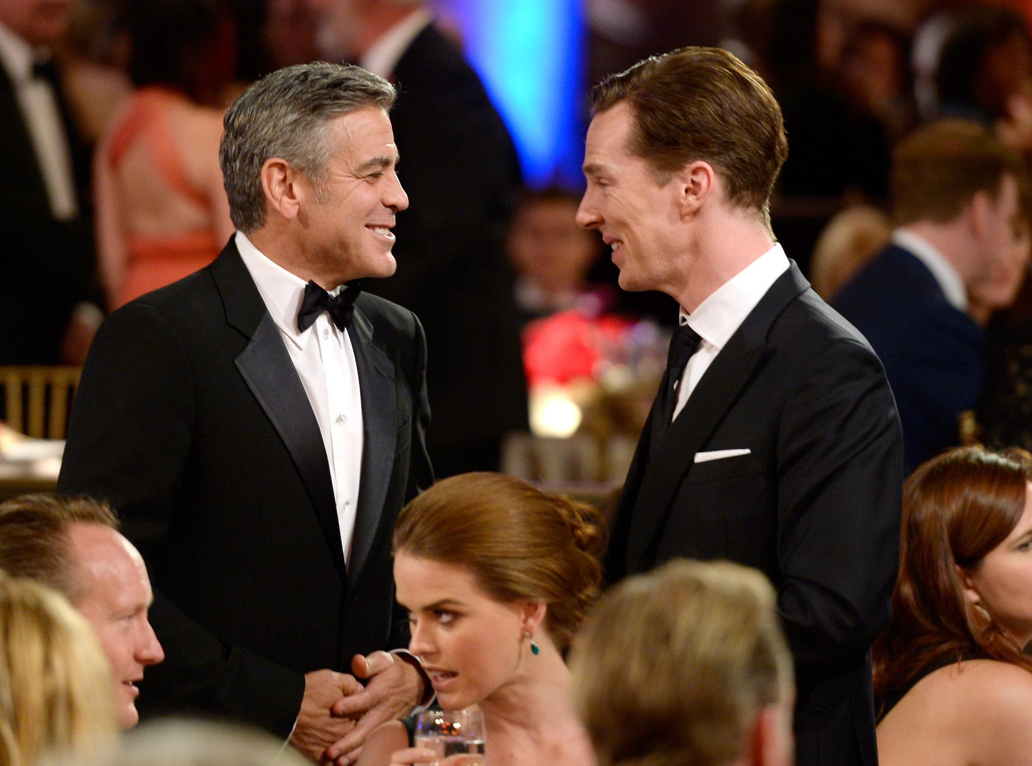 George Clooney mingled with Benedict Cumberbatch during the gala.