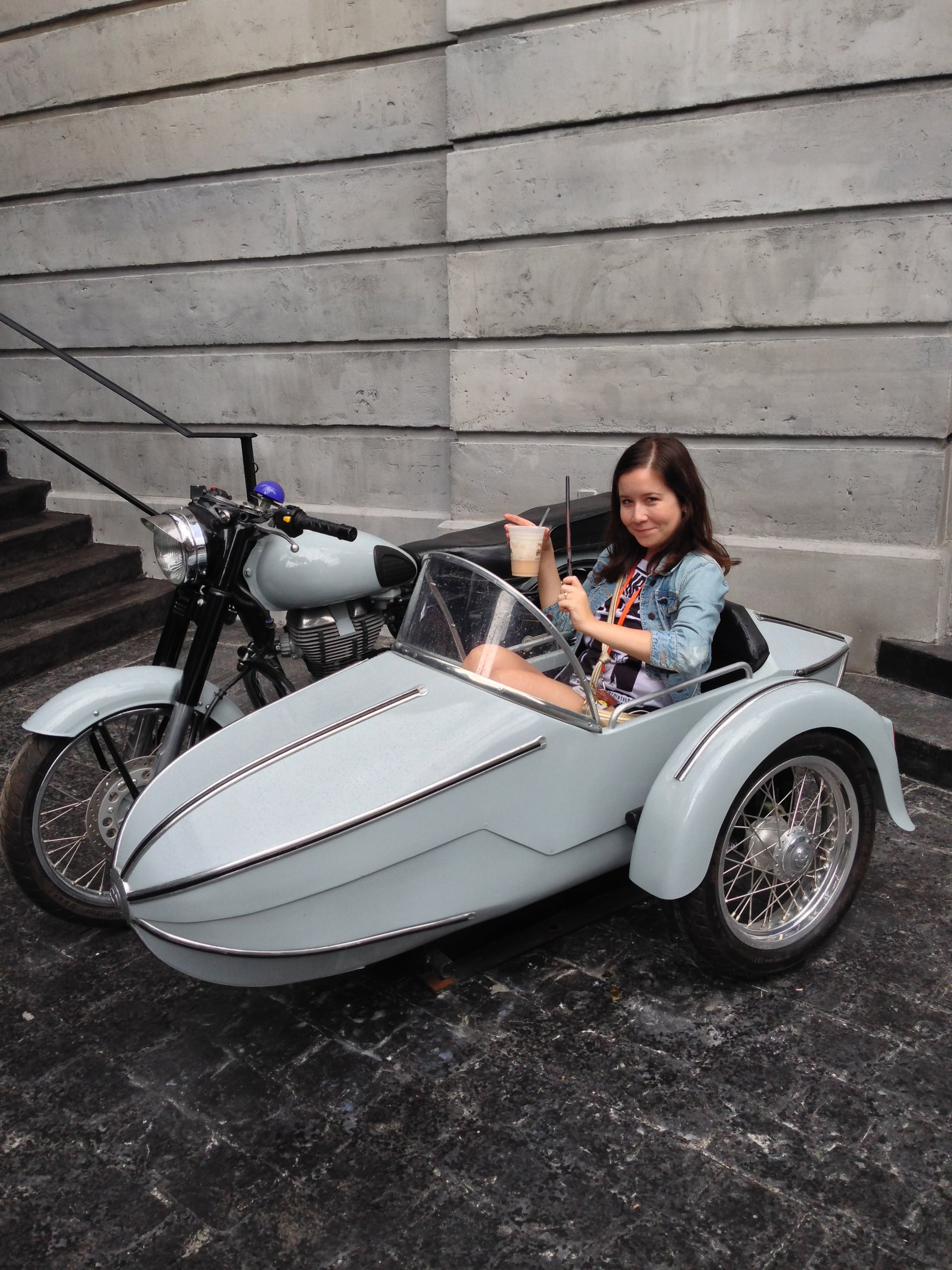"""Hagrid's motorbike in front of Gringott's makes for the perfect photo op —especially when you have a butterbeer in one hand and a wand in the other. But the coolest shot in the motorbike has to be this one Warwick Davis posted on Twitter with the caption """"Looking like a dodgy band's album cover."""""""