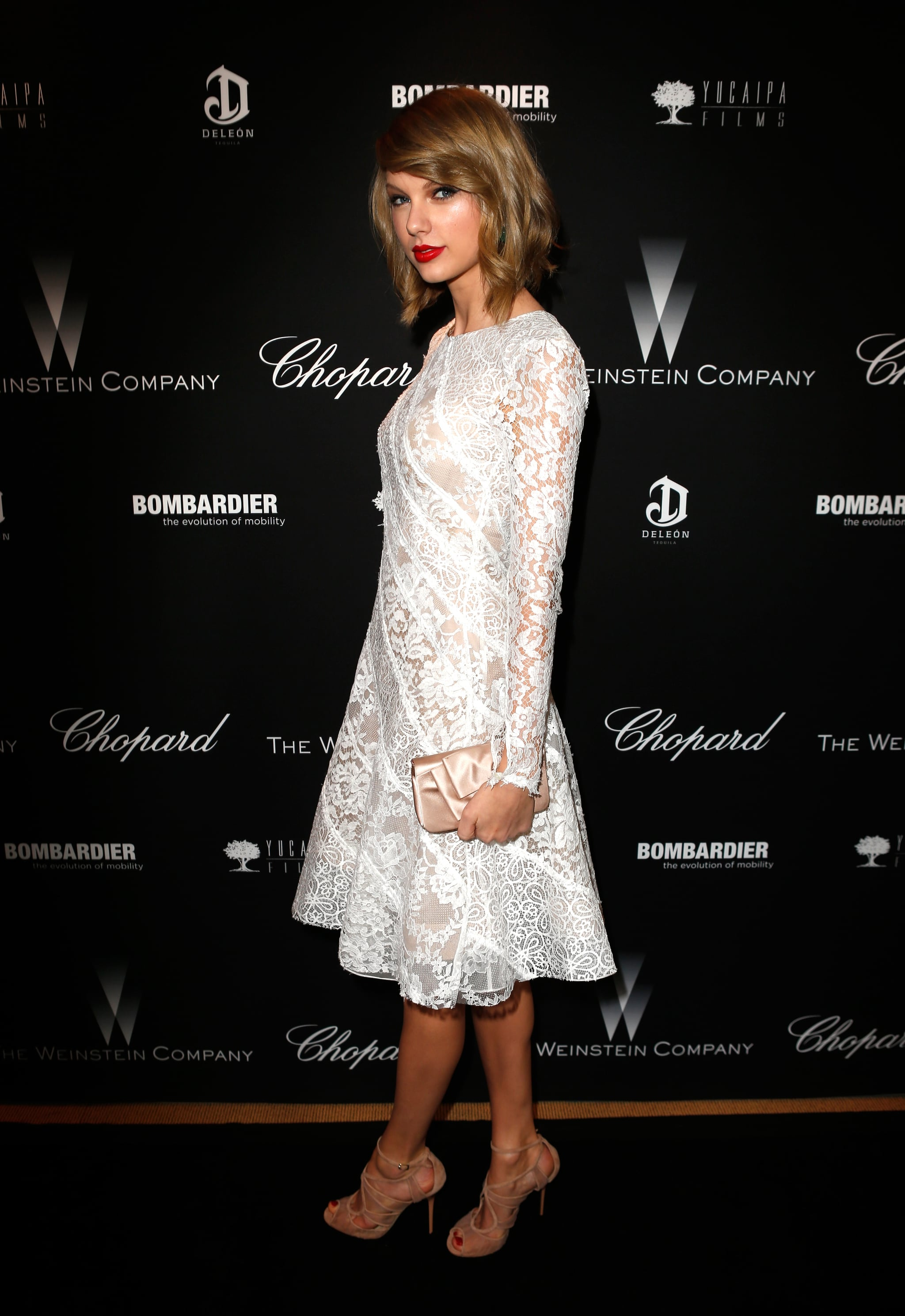 Taylor Swift looked elegant in white lace.